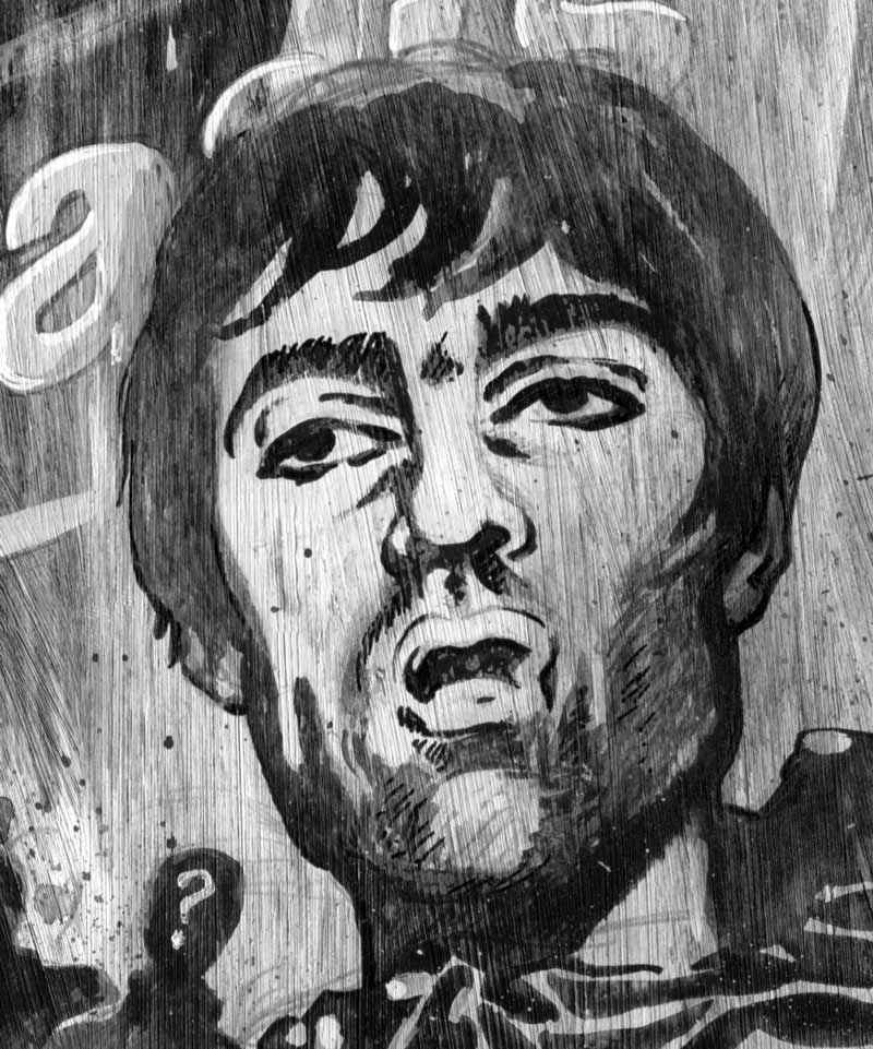 detail of newspaper illustration of oasis: liam gallagher